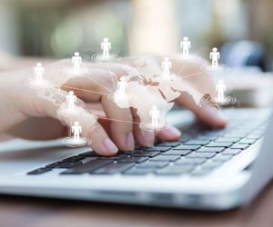 expert woman typing on a laptop at aerobusinesssolutions abs best search engine optimization seo company in bangalore india national and global search engine optimization services best