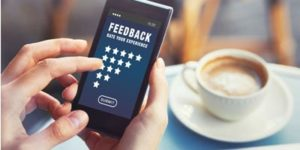 providing feedback on the mobile phone online | review generation and social media integration of websites by ABS web design company in bangalore