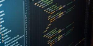 multiple lines of code on a laptop screen | web design and development company in bangalore india